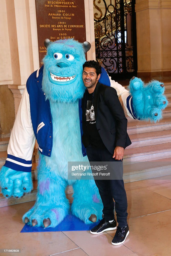 Humorist Jamel Debbouze (voice of Art) poses at 'Monsters University' Paris movie premiere, held at La Sorbonne on June 26, 2013 in Paris, France.