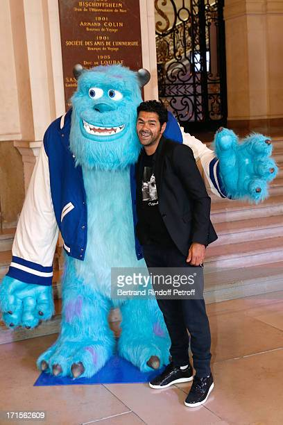 Humorist Jamel Debbouze poses at 'Monsters University' Paris movie premiere held at La Sorbonne on June 26 2013 in Paris France