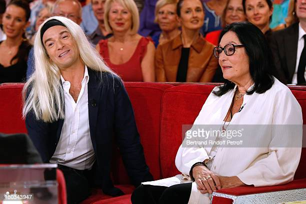 Humorist Jonathan Lambert and singer Nana Mouskouri attend 'Vivement Dimanche' French TV Show at Pavillon Gabriel on September 11 2013 in Paris France