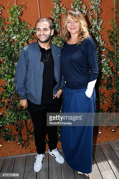 Humorist Malik Bentalha and Actress Julie Ferrier attend the 2015 Roland Garros French Tennis Open Day Eleven on June 3 2015 in Paris France