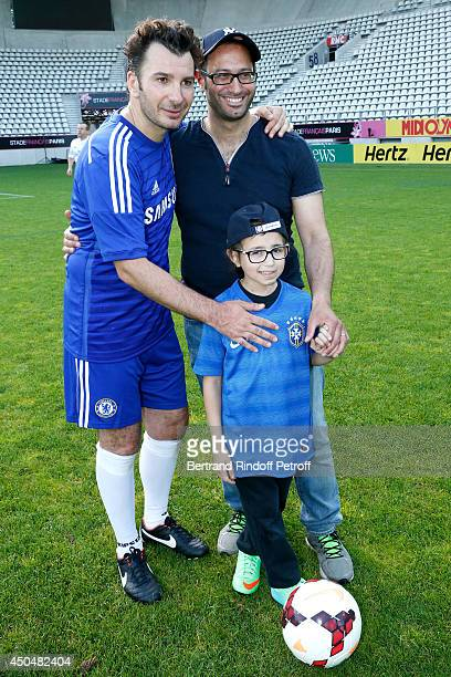 Humorist Michael Youn Samuel and his father attend the Football match for the benefit of the association 'Plus fort la vie' at Stade Jean Bouin on...
