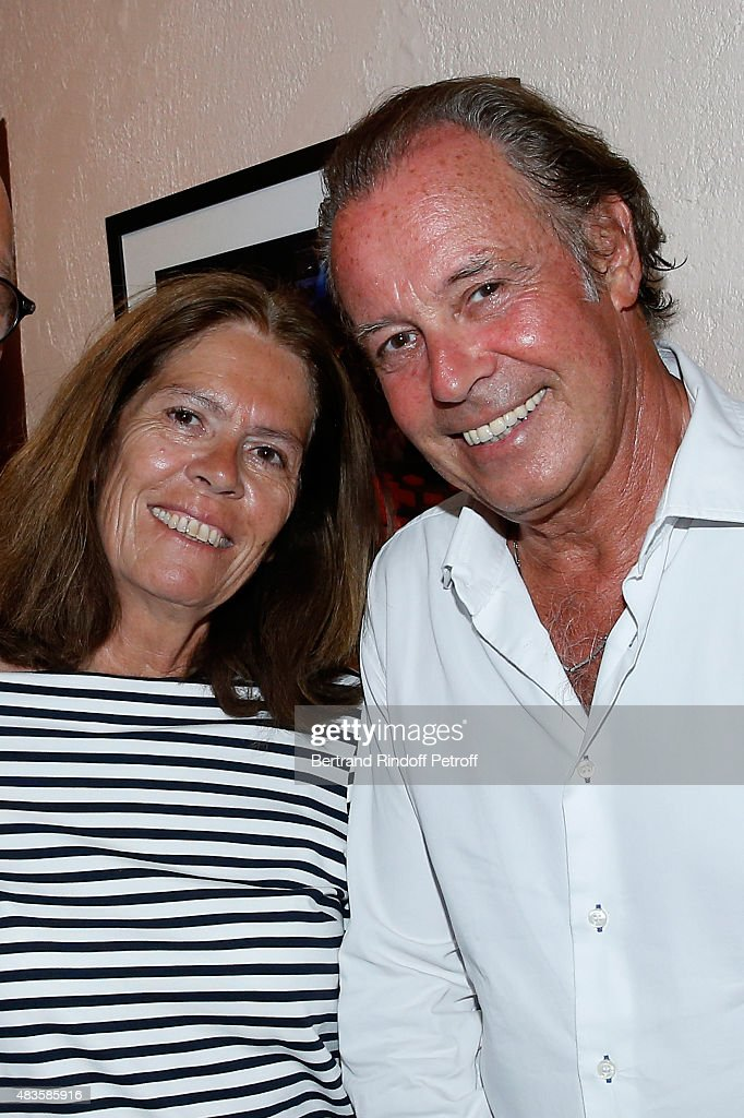 Humorist Michel Leeb and his wife Beatrice pose Backstage after the 'Michel Leeb Part en Live !' show, accompanied by the music band 'The Messangers', during the 31th Ramatuelle Festival : Day 9, on August 9, 2015 in Ramatuelle, France.