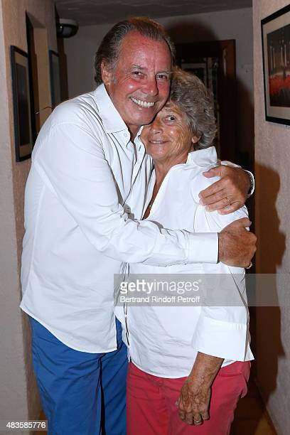 Humorist Michel Leeb and President of Ramatuelle Festival Jacqueline Franjou pose Backstage after the 'Michel Leeb Part en Live ' show accompanied by...