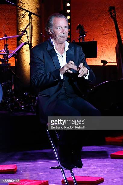 Humorist Michel Leeb performs in his 'Michel Leeb Part en Live ' show accompanied by the music band 'The Messangers' during the 31th Ramatuelle...