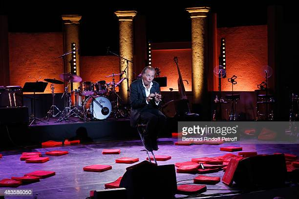 Humorist Michel Leeb performs in 'The typewriter' after the traditional throw of cushions at the final of his 'Michel Leeb Part en Live ' show...
