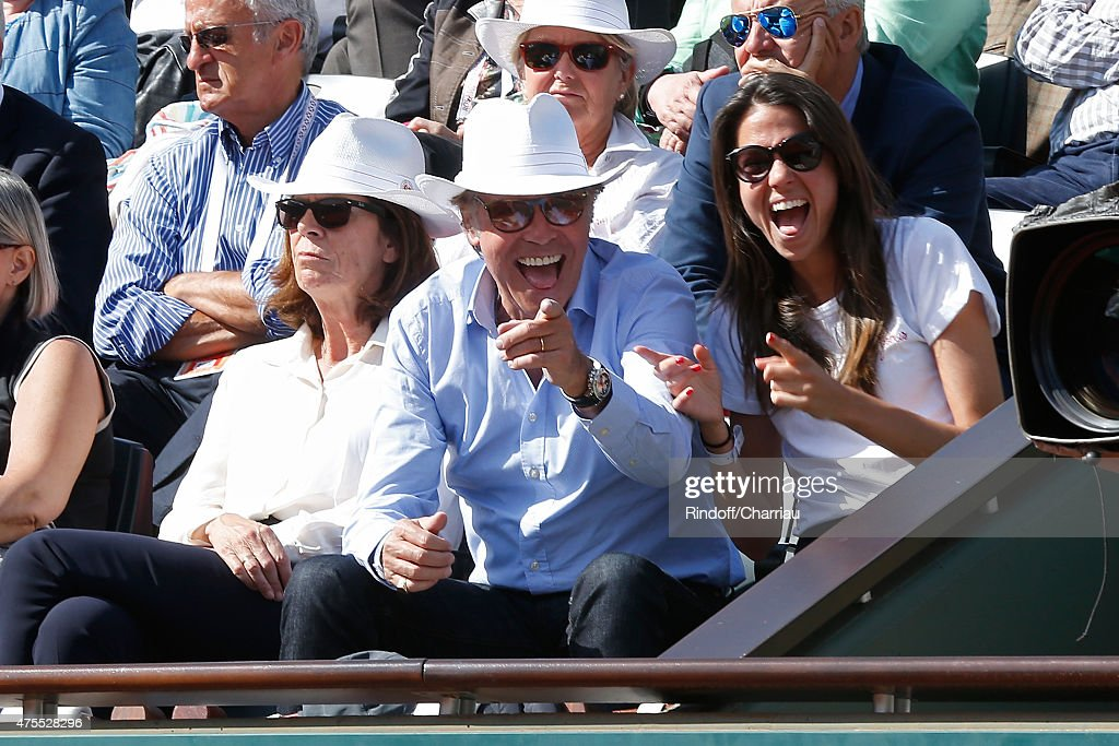 Humorist Michel Leeb sitting between his wife Beatrice and their daughter Elsa attend the 2015 Roland Garros French Tennis Open - Day Nine on June 1, 2015 in Paris, France.