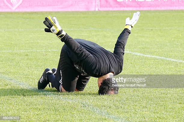 Humorist Raphael Mezrahi plays the Football match for the benefit of the association 'Plus fort la vie' at Stade Jean Bouin on June 9 2014 in Paris...