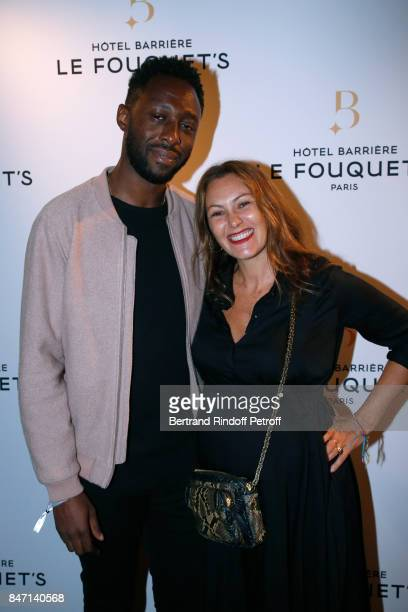 Humorist Thomas N'Gijol and his wife actress Karole Rocher attend the Reopening of the Hotel Barriere Le Fouquet's Paris decorated by Jacques Garcia...