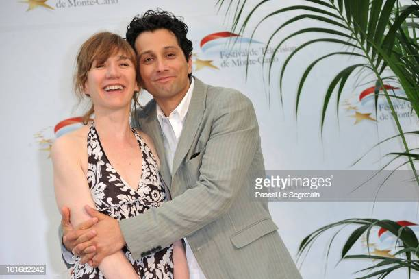 Humorist Virginie Lemoine and Darius pose at a photocall for the TV series 'Famille d'accueil' during the 2010 Monte Carlo Television Festival held...