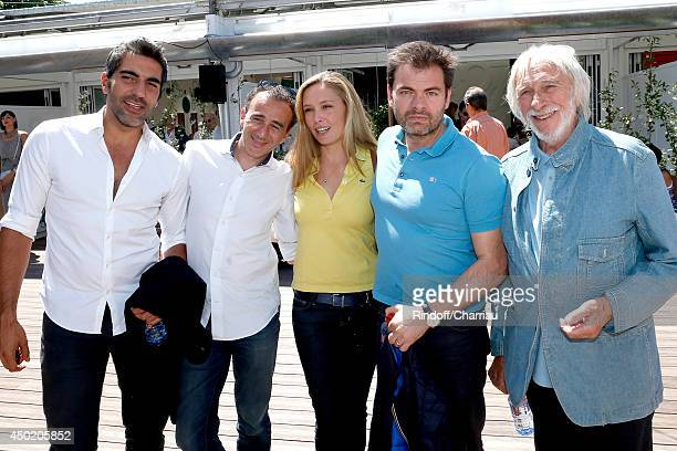 Humorists Ary Abittan Elie Semoun actors Clovis Cornillac with his wife Lilou Fogli and Pierre Richard attend the Roland Garros French Tennis Open...