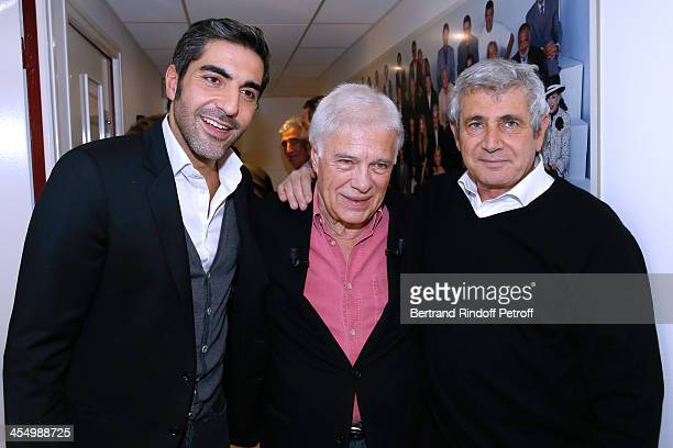 Humorists Ary Abittan Guy Bedos and Michel Boujenah attend 'Vivement Dimanche' French TV Show at Pavillon Gabriel on December 10 2013 in Paris France