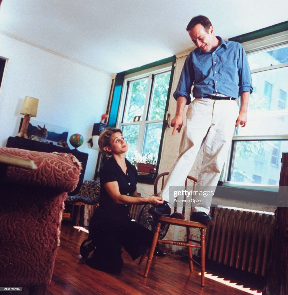 Humorist/writer <a gi-track='captionPersonalityLinkClicked' href=/galleries/search?phrase=David+Sedaris&family=editorial&specificpeople=1056693 ng-click='$event.stopPropagation()'>David Sedaris</a> is standing on chair as his sister Amy adjusts the hem on his pants, at his apt.