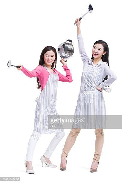 Humorous best female friends ready cooking