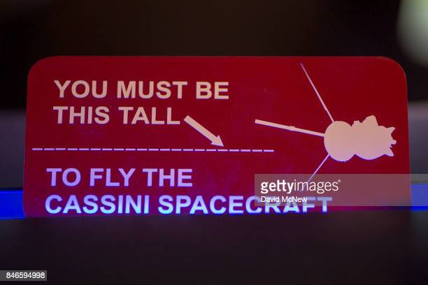 A humorous sign is seen on the Cassini Mission Ace desk in JPL Mission Control at Jet Propulsion Laboratory as NASA's Cassini spacecraft nears the...