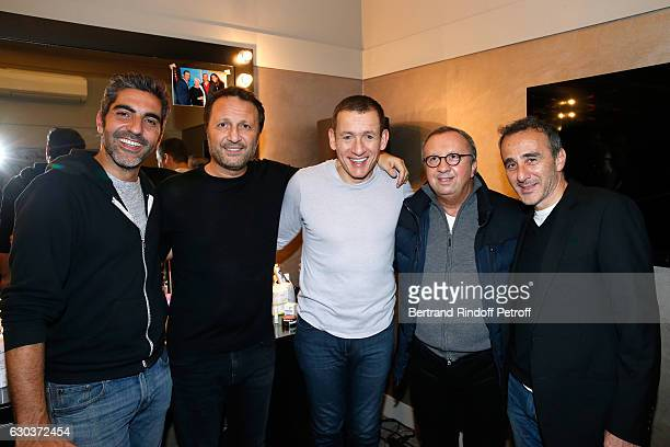 LR Humorsits Ary Abittan Arthur Essebag Dany Boon Doctor Roland Levy and humorist Elie Semoun pose Backstage after the triumph of the 'Dany De Boon...