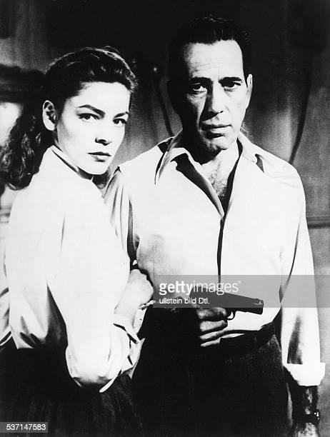 Humphrey Bogart and Lauren Bacall at the film 'Key Largo'