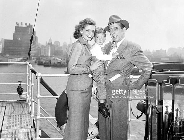 Humphrey Bogart his wife Lauren Bacall and their son Stephen look very pleased on returning home aboard the Ile de France Movie couple had been in...