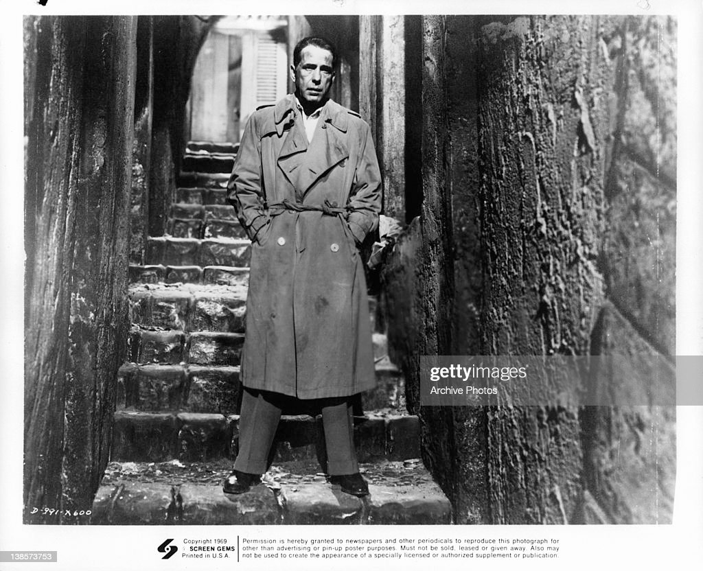 Humphrey Bogart standing in stairway in a scene from the film 'Sirocco', 1951.