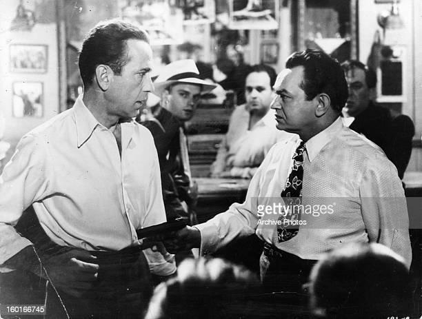 Humphrey Bogart talks to Edward G Robinson in a scene from the film 'Key Largo' 1948