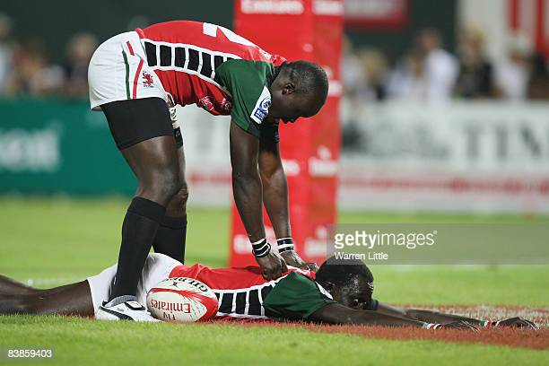 Humphrey Kayange of Kenya dives over tyo score a try against Samoa in the Plate Final of the Emirates Airline Dubai Sevens at The Sevens on November...