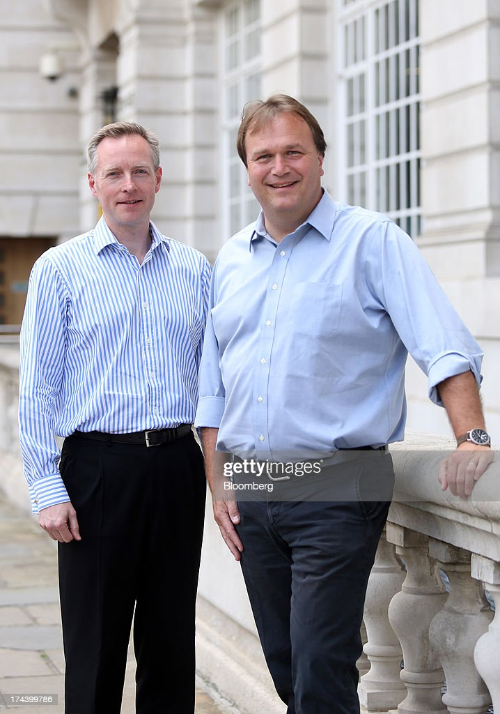 Humphrey Singer, group finance director of Dixons Retail Plc, left, and Sebastian James, chief executive officer of Dixons Retail Plc, pose for a photograph in London, U.K. on Thursday, July 25, 2013. The owner of the PC World and Currys chains is training staff to improve customer relations and is selling higher-margin services to overcome cheaper online competitors. Photographer: Chris Ratcliffe/Bloomberg via Getty Images