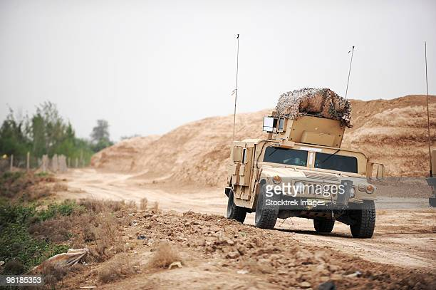 A Humvee conducts security during a patrol in the Iraqi village of Bakr.