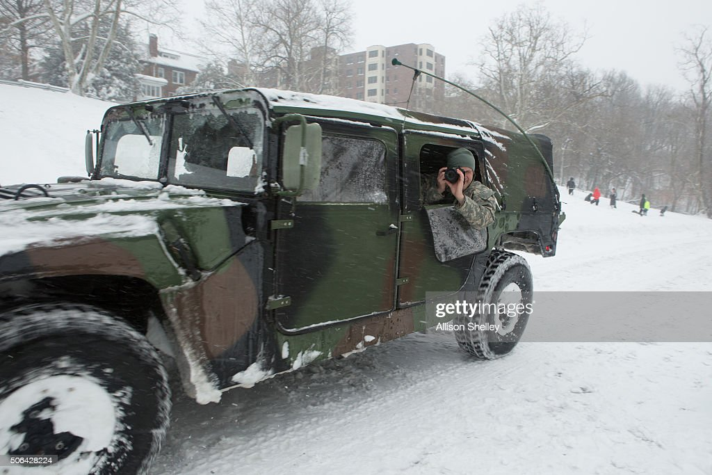 Humvee makes its way along Piney Branch Parkway in Rock Creek Park on January 23 2016 in Washington DC Over a foot of snow has already fallen in the...