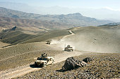 Humvees traveling through roads in Afghanistan.