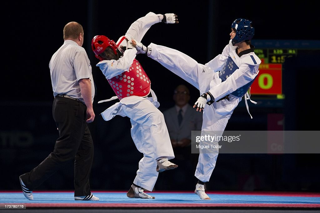 Hun Kim of Korea competes with Balla Dieye of Senegal during a Men's -68 kg final combat of WTF World Taekwondo Championships 2013 at the exhibitions Center on July 17, 2013 in Puebla, Mexico.