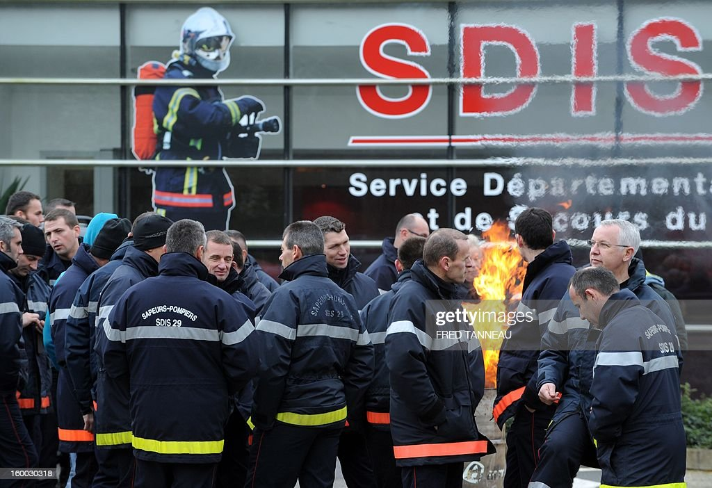 A hundred of firefighters demonstrate on January 25, 2013 to protest against their management conditions in Quimper, Brittany.