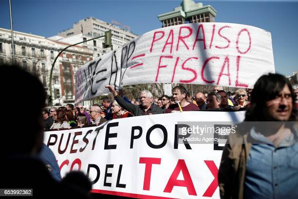 Hundred of taxi drivers who are on strike to protest take part in a protest against appbased car transport company Uber in Madrid Spain on March 16...