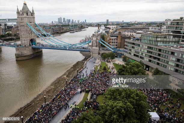 Hundreds gather during a vigil in Potters Fields for the victims of the June 3rd terror attacks on June 5 2017 in London England Seven people were...