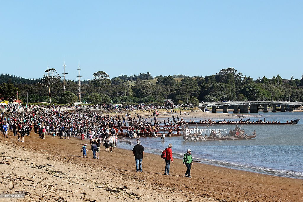 Hundreds gather on the beach to watch the waka in celebration of Waitangi Day on February 6, 2013 in Waitangi, New Zealand. The Waitangi Day national holiday celebrates the signing of the treaty of Waitangi on February 6, 1840 by Maori chiefs and the British Crown, that granted the Maori people the rights of British Citizens and ownership of their lands and other properties.