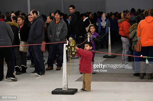 Hundreds line up for the 86th annual Denver Santa Claus Shop at the old Kmart store near Evans Ave and Monaco St December 09 2016 The mission is to...