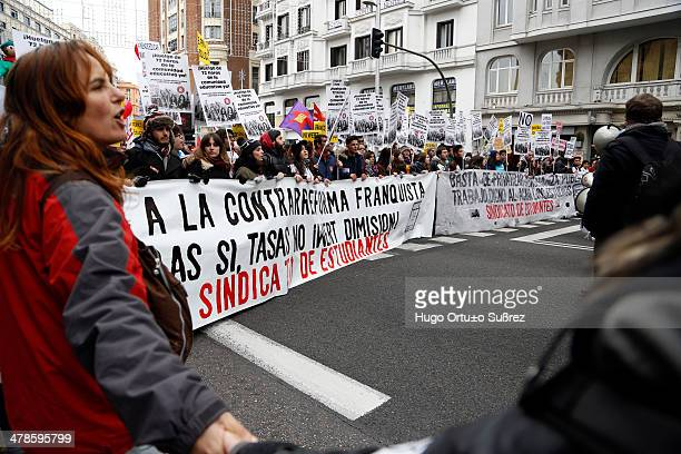 Hundreds marched through several streets of Madrid on a new protest called by the State Platform for Public School against the Law for the...