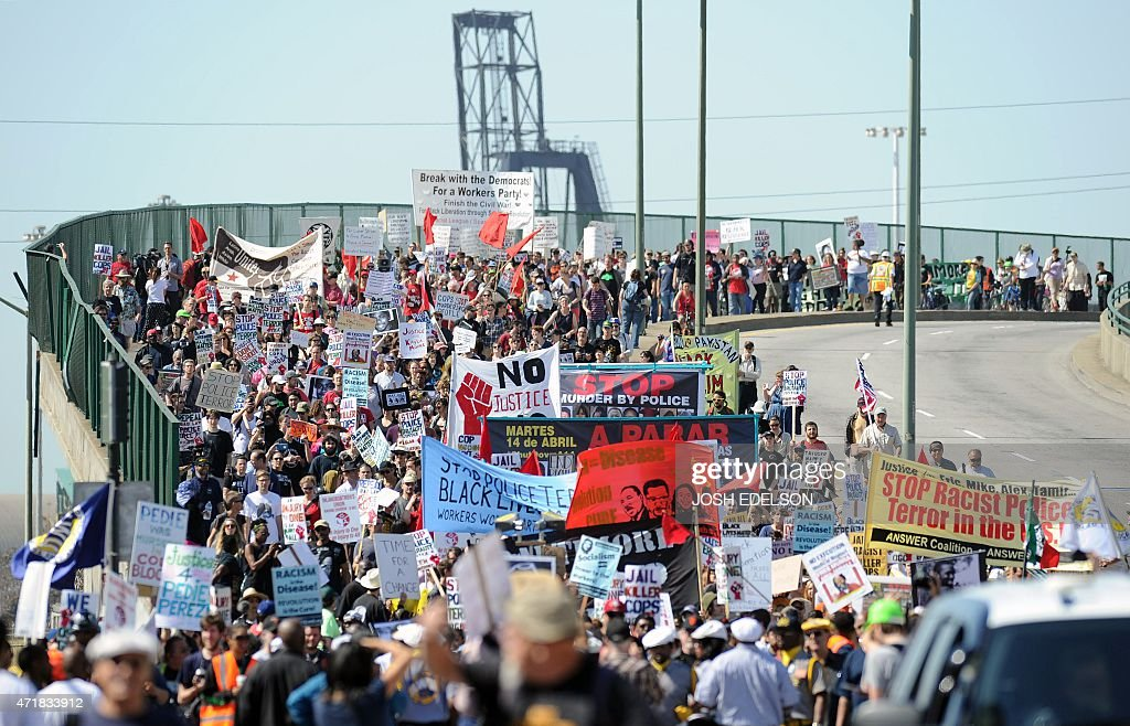 Hundreds of activists march from the Port of Oakland as part of May Day protests in Oakland California on May 1 2015 Protests are expected to...