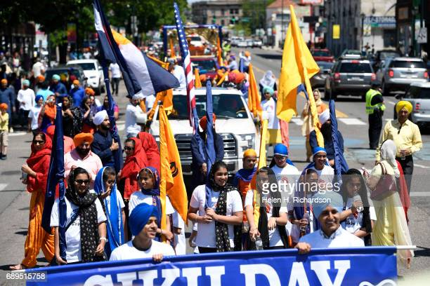 Hundreds of American Sikhs march down Colfax avenue as they take part in the during the second annual American Sikh day parade march by on May 28...