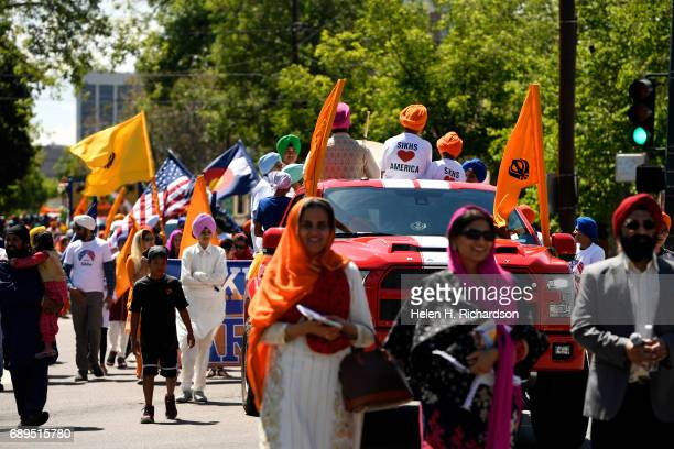 Hundreds of American Sikhs take part in the second annual American Sikh day parade march by on May 28 2017 in Denver Colorado The Sikhs hold the...