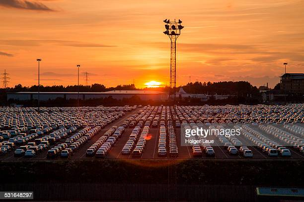 Hundreds of automobiles in lot at port