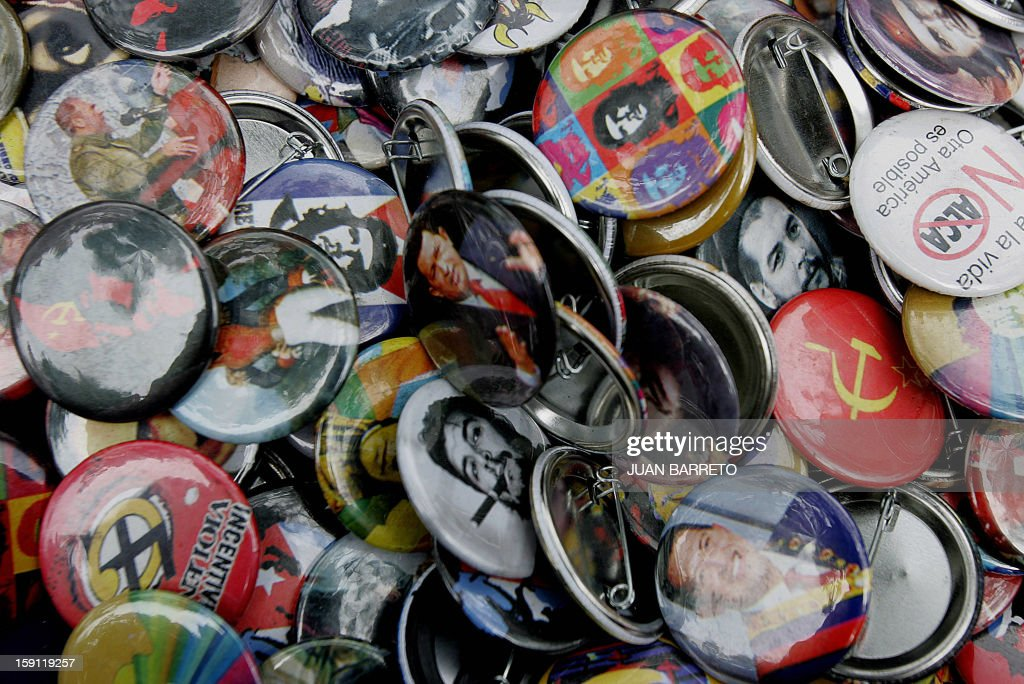 Hundreds of badges with images of Latin American leaders and political issues are displayed to be sold during the World Social Forum in Caracas 28...