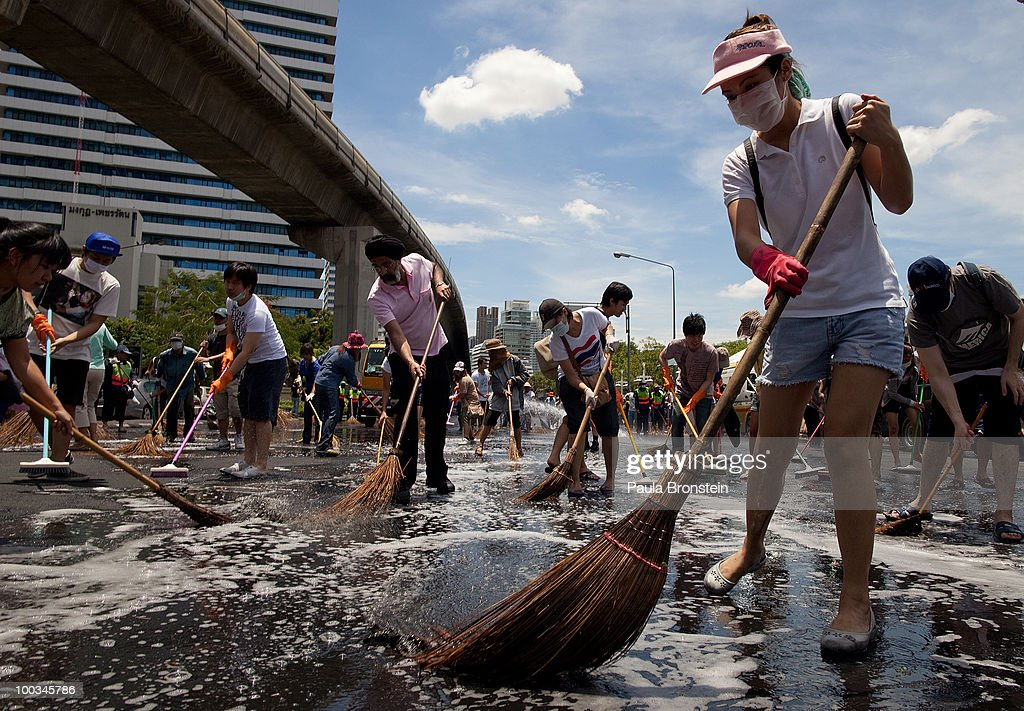 Hundreds of Bangkok residents participate in a Bangkok Clean Up day sweeping up the streets with soap and water May 23, 2010 in Bangkok, Thailand. A reduced night-time curfew remains in place in Bangkok to prevent a resurgence of unrest. At least 86 people have been killed in clashes with military forces since mid-March when the political turmoil took hold. Bangkok experienced its worst political violence in decades during the Red Shirt occupation ending with the military crackdown on the camp causing the redshirts to take revenge setting fire to buildings, including the country's stock exchange and biggest shopping mall, the CentralWorld.