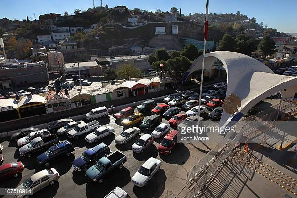 Hundreds of cars wait to pass from Mexico into the United States at the border crossing on December 10 2010 in Nogales Arizona Despite Arizona's...