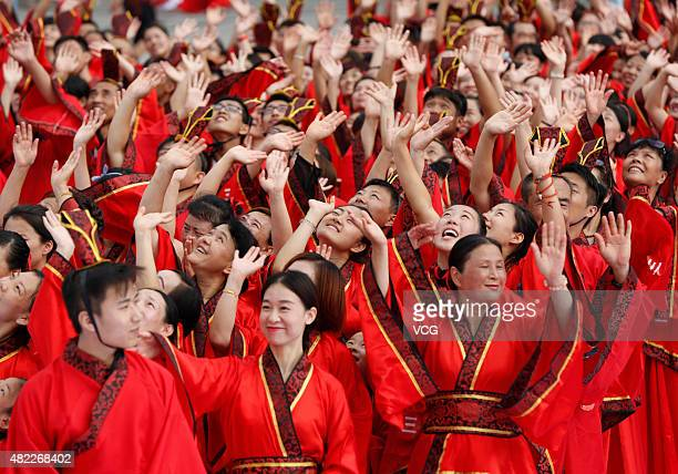 Hundreds of Chinese people from all over the world wearing Han Chinese clothes form a Chinese word 'Gen' which means 'Root' during an ancestral...