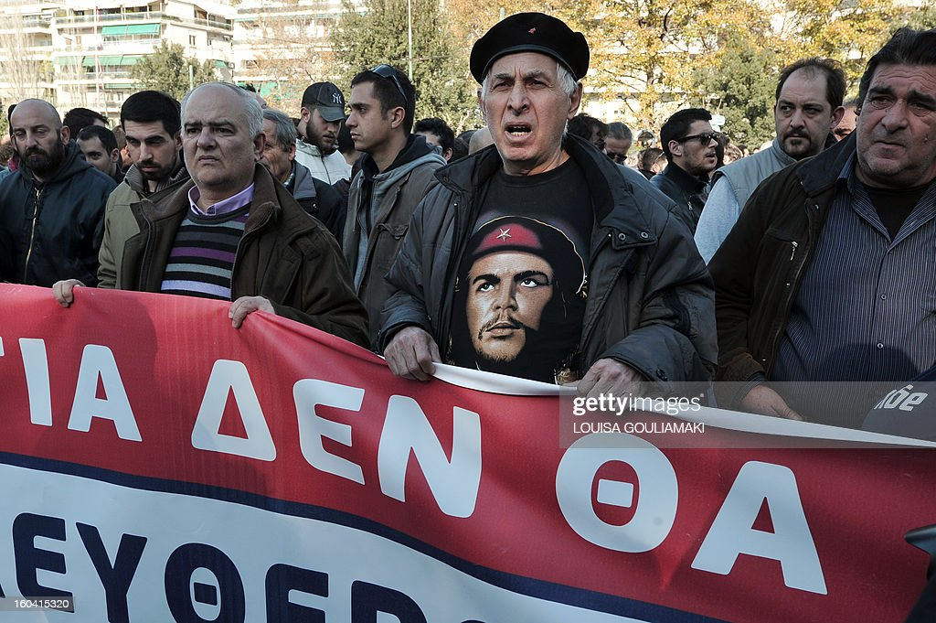 Hundreds of communist affiliated protesters gather in front of the Athens court to support their arrested colleagues on January 31, 2013. Around 30 Communist unionists were arrested after attempting to occupy the office of Labour Minister Yiannis Vroutsis on January 30th. Vroutsis had previously announced a new pension overhaul. A street protest was organised outside the Athens court complex on Thursday morning to demand the release of those arrested.