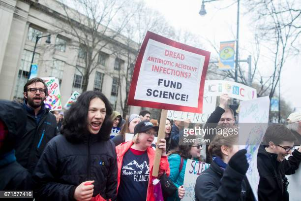 Hundreds of community members from Harvard University and MIT march towards the Massachusetts Avenue Bridge to join the Science March at the Boston...