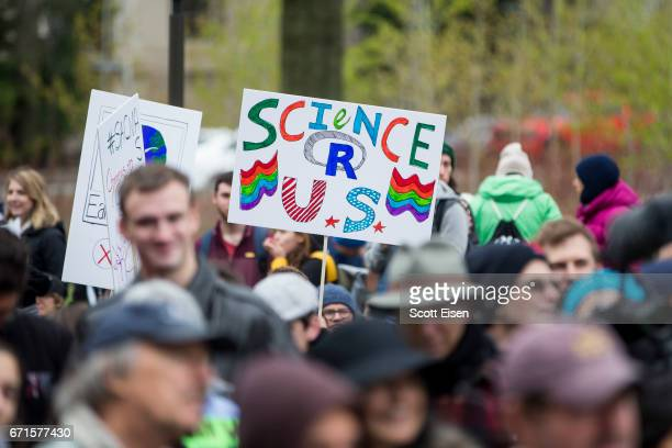 Hundreds of community members from Harvard University and MIT march across the Massachusetts Avenue Bridge to join the Science March at the Boston...