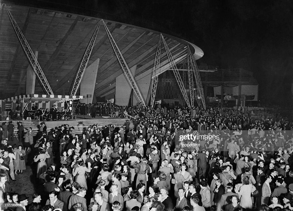 Hundreds of couples dancing to the music of Geraldo's Embassy Orchestra outside the Dome of Discovery during the Festival of Britain on the South Bank, London, 16th August 1951.