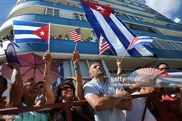 Hundreds of Cubans and visitors from other countries gather across the street from the newly reopened US Embassy to observe the flagraising ceremony...
