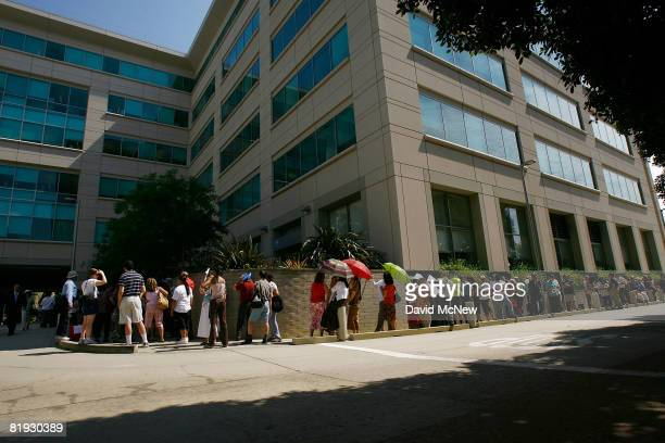 Hundreds of customers wait in line to get into an IndyMac Bank open for the first time since the July 11 federal government takeover of the thrift on...