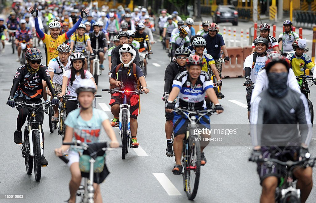 Hundreds of cyclists take part in an 'Ice Ride' to mark 'World Car Free Day' in Manila on September 15, 2013. Environmental activists from Greenpeace and the local group 'Firefly Brigade' took to their bikes to pedal 14 kilometers (9 miles) to join an 'Ice Ride', a global mass bike ride taking place in 110 cities in 36 countries aimed at saving the Arctic. World Car Free Day usually takes place in mid-September and is an annual celebration of cities and public life, free from the noise, stress and pollution of cars aimed at getting people to think about their car use and its impact on the environment, as well as promoting alternatives. AFP PHOTO / Jay DIRECTO